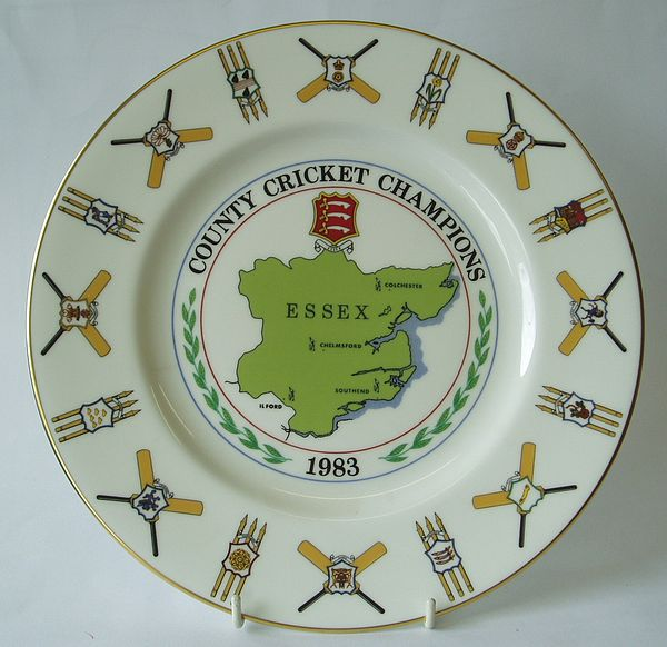 A Coalport china plate decorated with a central design of a county map and badge. The outer rim incorporates a design of seventeen county badges with bats and stumps.